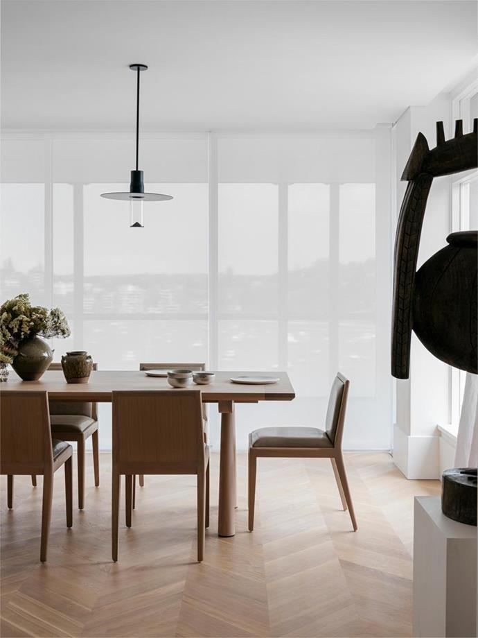 "Viabizzuno 'Royal Sospensione' pendants stand out against the sheer white curtains that shade this [minimalist home](https://www.homestolove.com.au/harbourside-apartment-with-minimalist-interior-21376|target=""_blank"") and dining room from its spectacular harbour views."