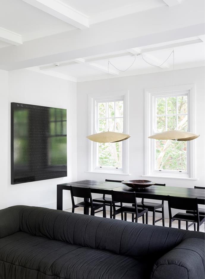 "Gervasoni pendant lights from Anibou made a modern statement in this [monochrome arts and crafts apartment in Potts Point](https://www.homestolove.com.au/monochrome-arts-and-crafts-apartment-20401|target=""_blank"")."