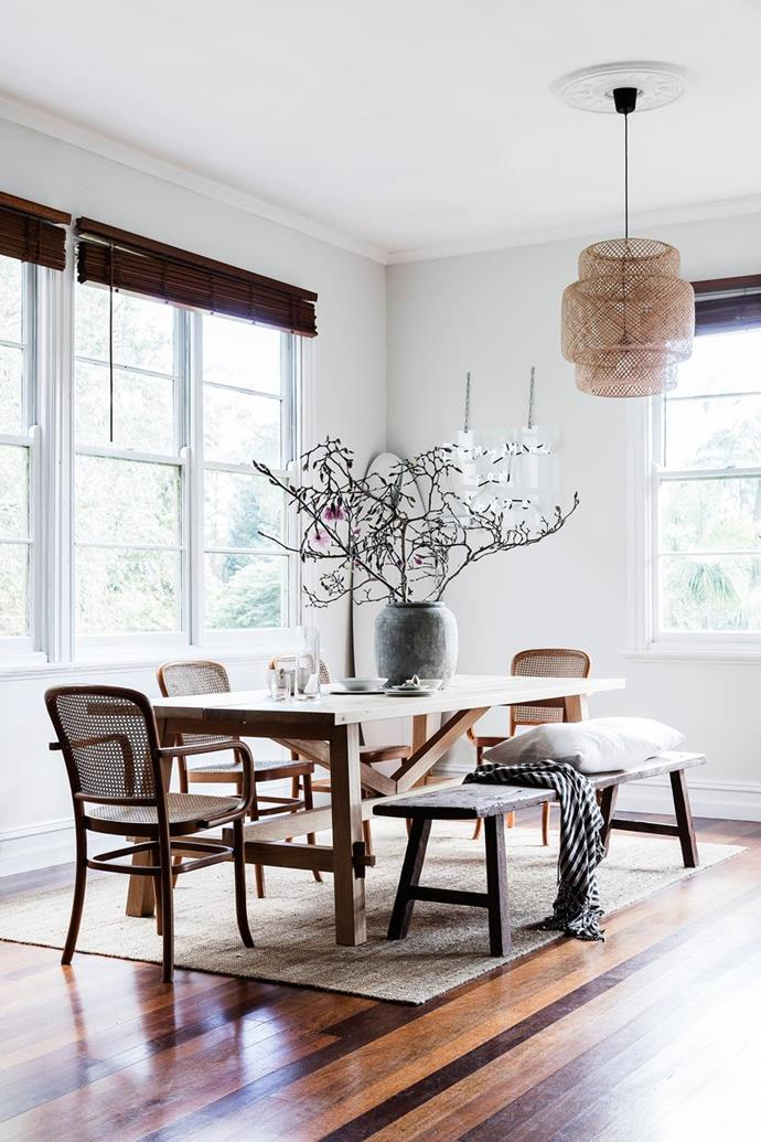 "As the creative couple who live in [this Byron Bay cottage](https://www.homestolove.com.au/minimalist-cottage-in-byron-bay-5881|target=""_blank"") like to entertain and often have friends and family staying, they recently turned the larger lounge room into their formal dining area with a rattan pendant from Worn Store."
