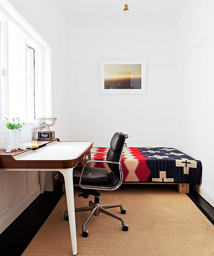 """Airy and inviting, the study in a [surfer's Art Deco apartment by the sea](https://www.homestolove.com.au/budget-bondi-bachelor-pad-3570