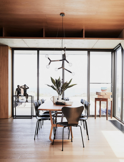 Sculpture by Mela Cooke. Phasmida Branch 5 suspension light, Christopher Boots. Jade dining table, Zuster. Series 7 dining chairs, Cult. American-oak flooring, Royal Oak Floors (throughout). Ceiling clad in American-oak veneer (throughout).