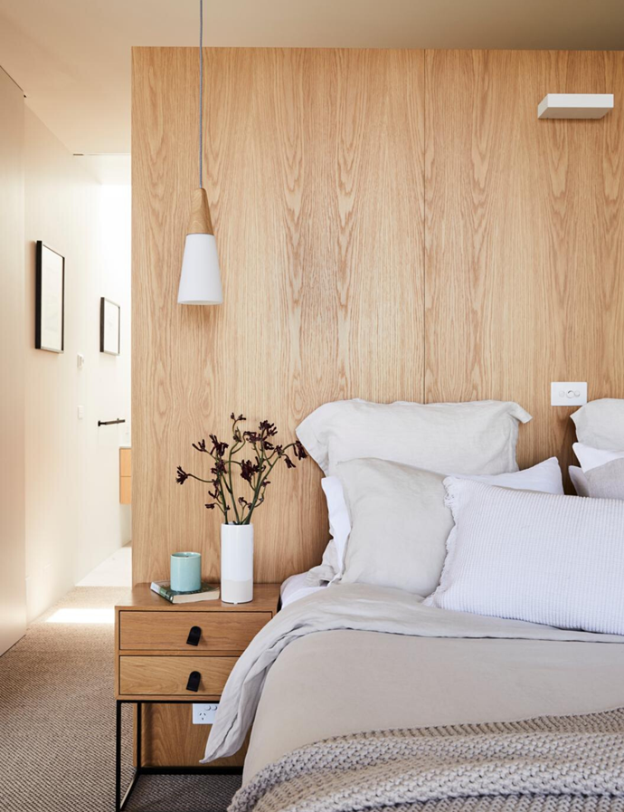Pendant light, Beacon Lighting. Bedside table, Adairs. Australian House & Garden vase, bedlinen, cushions and throw, all Myer. Carpet, Floorspace.
