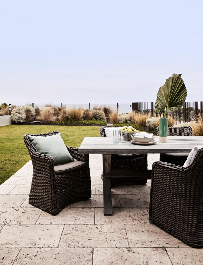 Travertine pavers. Table and chairs, Remarkable Outdoor Living.