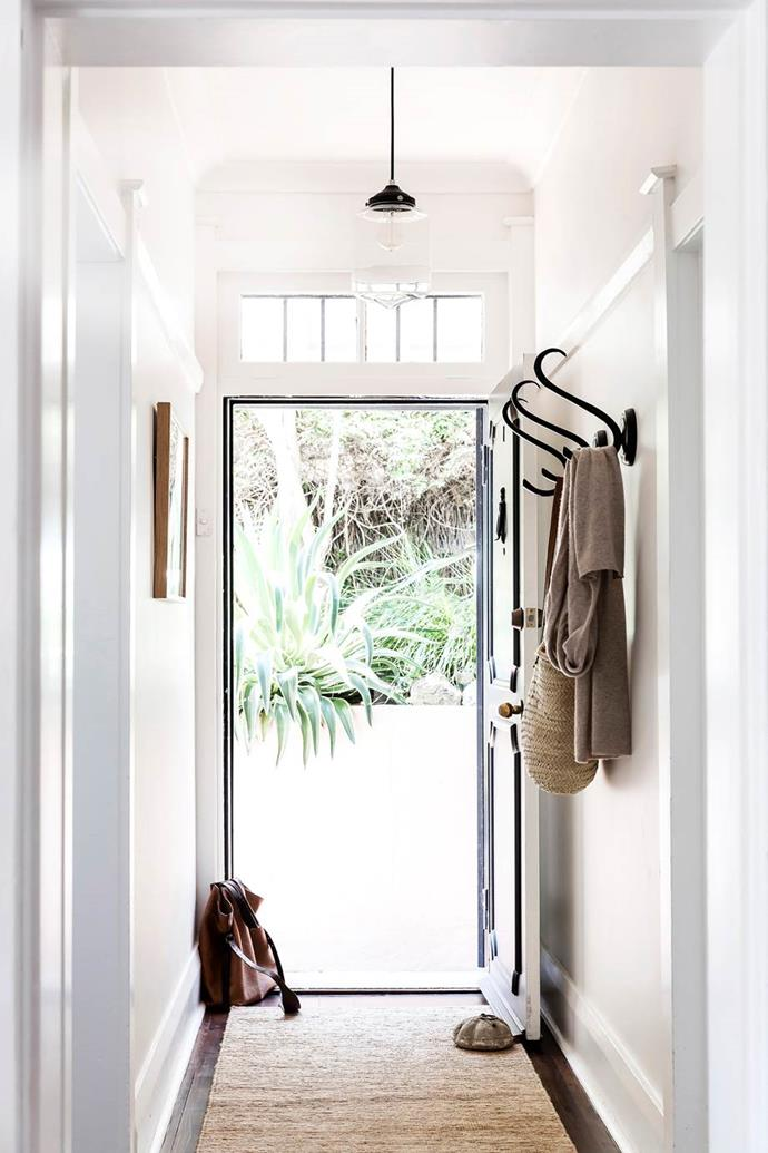 """If you have a small entryway or long or narrow hallway, opt for a clear pendant that's not too obtrusive like the classic on in this [Art Deco apartment in Sydney's Paddington](https://www.homestolove.com.au/country-coastal-decor-20537