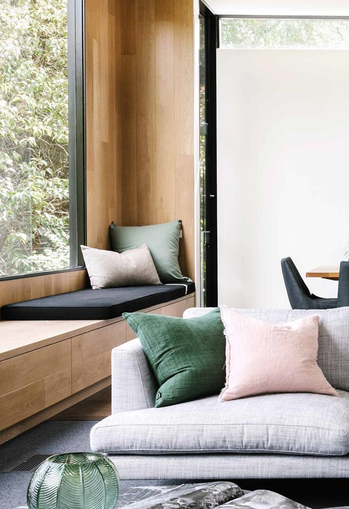 **Living room** The bench seat makes the most of the leafy outlook; it's clad in engineered European-oak boards with a clear two-pack finish. Pink cushions, [Aura Home](https://www.aurahome.com.au/). Green cushion, [Mulberi](https://www.furtex.co.nz/shop/++++MULBERI.html). Leather cushion, [Marvyn Interiors](https://mayvninteriors.com.au/pages/media).