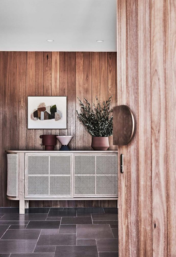 "**Entry hall** Blackbutt timber was used for the front door and wall cladding. Cabinet, [Life Interiors](https://www.lifeinteriors.com.au/|target=""_blank""