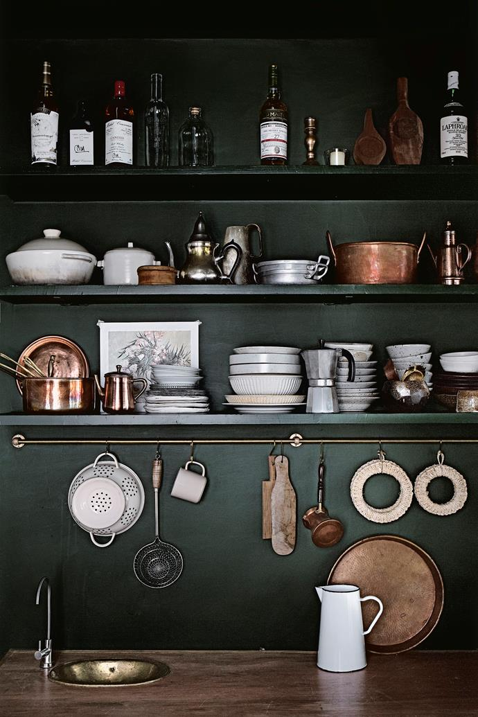"""Mandy displays her vintage copper and Japanese clay pots along the open shelves. """"My kitchen has to strike a balance between functionality and aesthetics."""""""