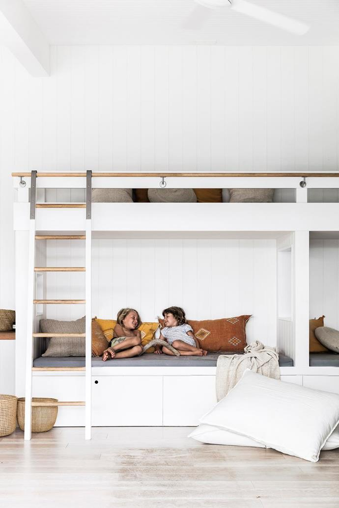 "Bunk beds are a great way to maximise seating in small spaces, and in this [Byron Bay bungalow](https://www.homestolove.com.au/a-coastal-weatherboard-home-byron-bay-19669|target=""_blank""), a pair of bunk beds, made by Vardy Build, create a kid-friendly zone with extra storage hidden underneath."