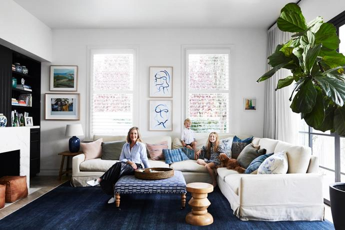 Terri perches on a custom ottoman covered in Manuel Canovas fabric; Sam and Chloe sit on a custom sofa. Rug, Armadillo & Co. Artworks by Lise Temple, Nunzio Miano.
