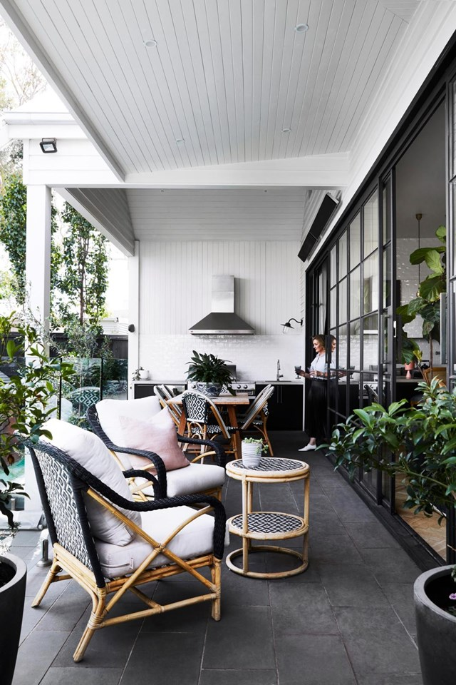 """Create a cohesive look and seamless indoor-outdoor flow by choosing plants and outdoor furniture that complement your interior aesthetic like the owners of this [weatherboard home in Melbourne](https://www.homestolove.com.au/renovated-white-weatherboard-home-melbourne-21530