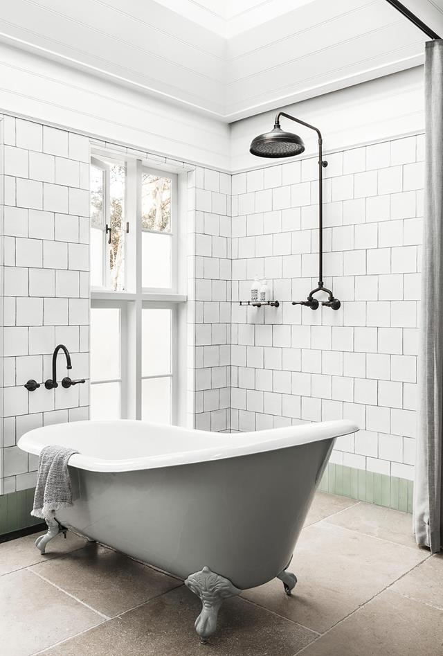 "A beautiful green freestanding tub makes a statement in this [elegant bathroom](https://www.homestolove.com.au/contemporary-update-for-a-sydney-heritage-home-19571|target=""_blank"") designed by architect Jeremy Bull."