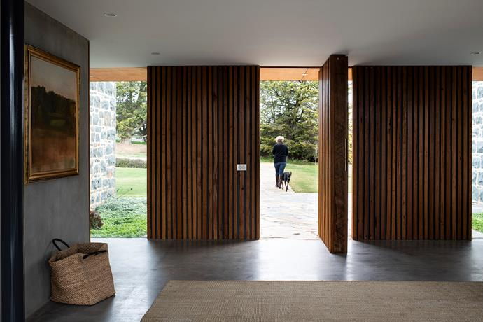 The main entrance features Southern Highlands by Bryan Westwood and a Cadrys rug.