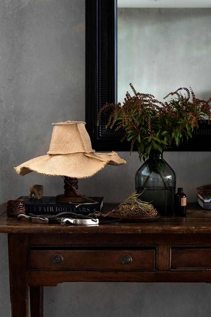 A hat from Hatmaker and a vase from Bison on an old console.