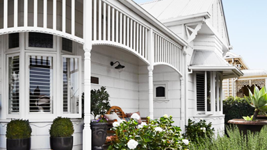 An interior designer's renovated white weatherboard home