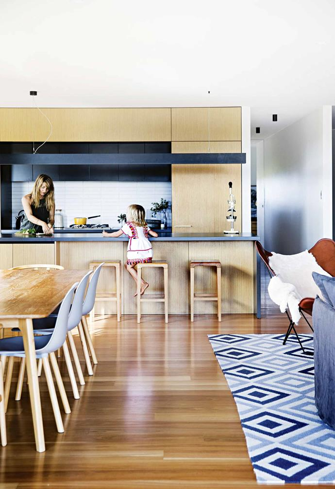 The purchasing process gave the couple a taste of the region's sense of community. The principal selling agent, Glen Irwin, also a farmer in the local area, is now a good friend, and is always on hand with a tractor or truck to help out when required.<br><br>**Kitchen** A Silestone benchtop in Cemento Spa complements the darker tones seen in the space, with the warmth of the timber veneer cabinetry creating a striking contrast.