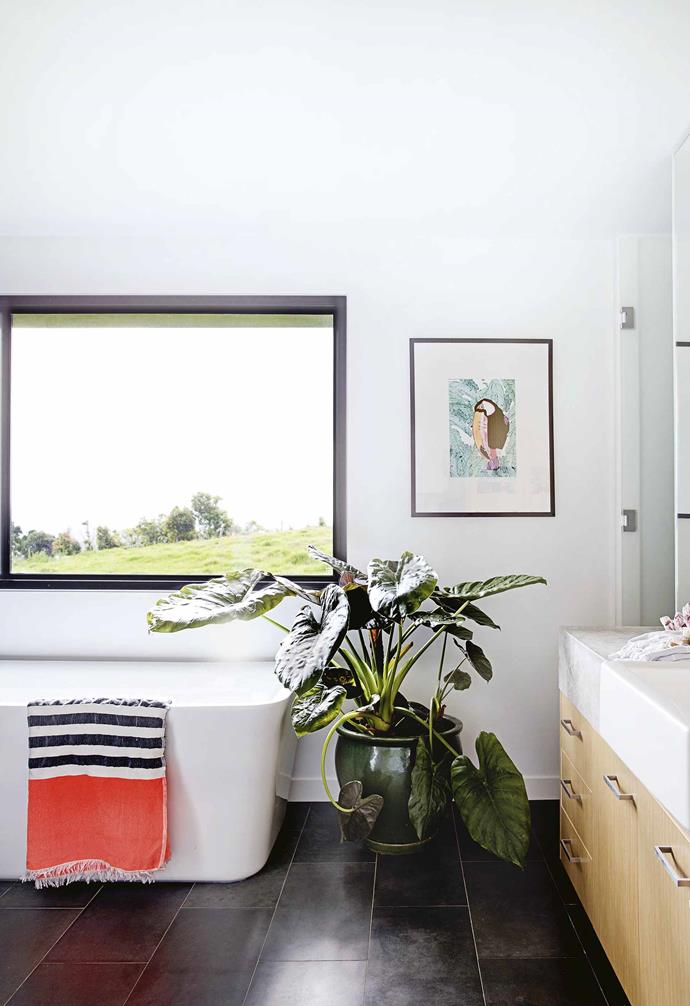 """Soon after buying the property, Yvonn and David became parents. Matilda and Frida were both born during the renovation and the couple admits it did test them at times. But now that the house is finished, they are making the most of the natural surrounds.<br><br>**Ensuite** The [freestanding bathtub](https://www.homestolove.com.au/freestanding-bath-design-ideas-4520 target=""""_blank"""") is in an ideal spot for watching in the daily march of the cows. The towel is by Gatinha Beachwear."""