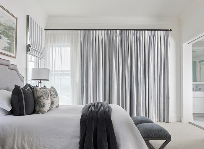 Custom bedhead with bronze-stud detailing, bed end stools, throw, curtains and table lamp, all Highgate House. Custom cushions in Manuel Canovas Sona. Tussore carpet in Sumac, Cavalier Bremworth.