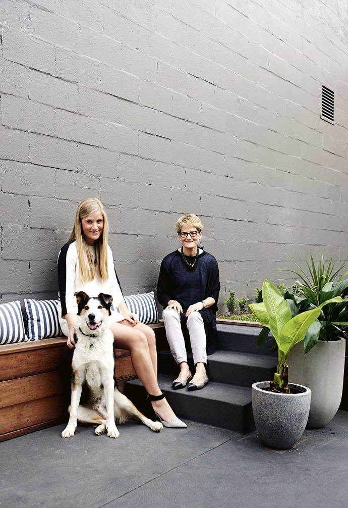 "Knowing they'd eventually [sell the house](https://www.homestolove.com.au/5-different-ways-you-can-sell-your-home-7181|target=""_blank""), the most important part of Lu and Georgie's brief was to articulate who they could see living in the property. The pair agreed the newly transformed abode would serve a young growing family who still wanted to enjoy a home with slick, contemporary styling.<br><br>**Portrait** Interior designer Georgie (sitting with dog Mack) worked with her mum Lu on this project to update a period house into a contemporary family home."