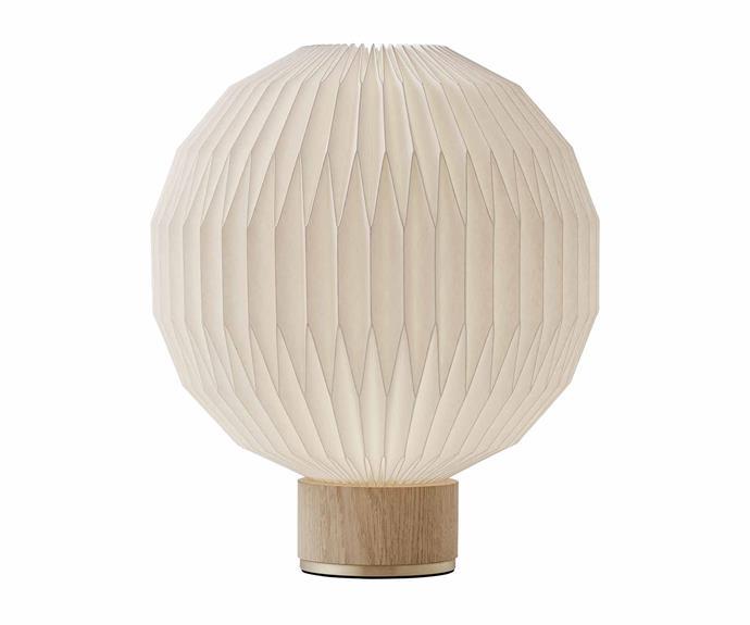 "Le Klint 'Model 375' table lamp, $1450, [Great Dane](https://greatdanefurniture.com/|target=""_blank""|rel=""nofollow"")."