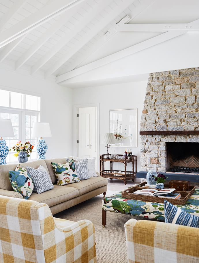High truss ceilings and the stone fireplace in the living room.
