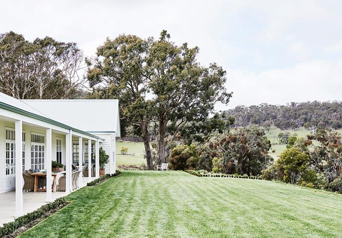 The verandah looks onto a lush lawn.
