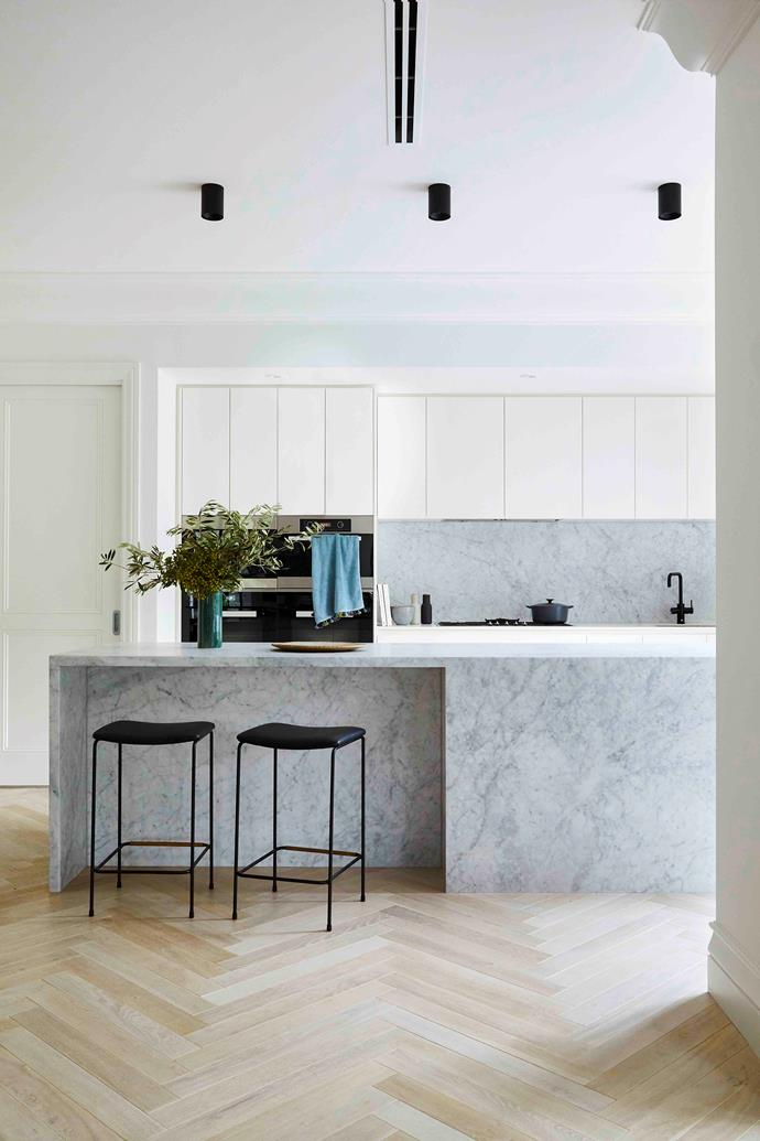The cooking zone has undergone a total transformation with luxe Carrara marble from Gladstones Granite defining the room. A plethora of storage behind the 2-pac cabinetry in Dulux Natural White is a highlight as are Grazia & Co 'Dita' stools that offer a spot to perch at the breakfast bar.