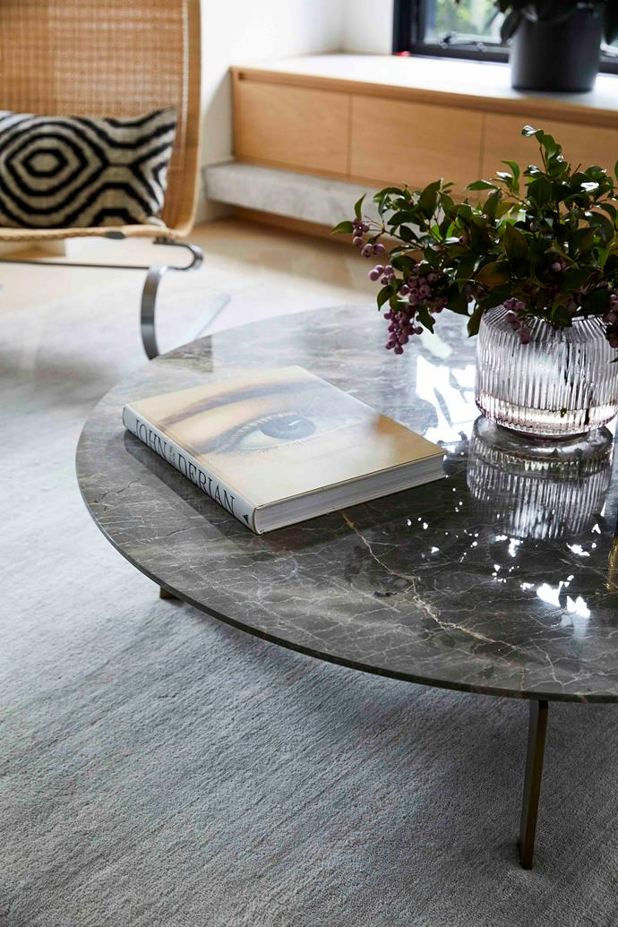 A shapely Marmoset Found vase atop a marble coffee table by Poliform.