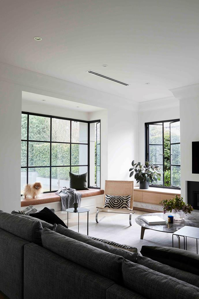 Austin Design Associates layered the core living space with textural pieces, including the expansive 'Bristol' sofa and 'Tribeca' coffee table by Poliform, and a Fritz Hansen 'PK20' wicker armchair accessorised with a black and white 'Zulta' cushion found at Fenton & Fenton.