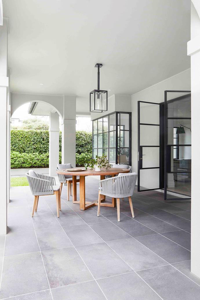 """Outside, a bluestone-paved loggia hosts year-round entertaining at the Manutti 'Siena' table and 'Mood' chairsby Tribu from Cosh Living. """"I do love my garden,"""" says Annette."""