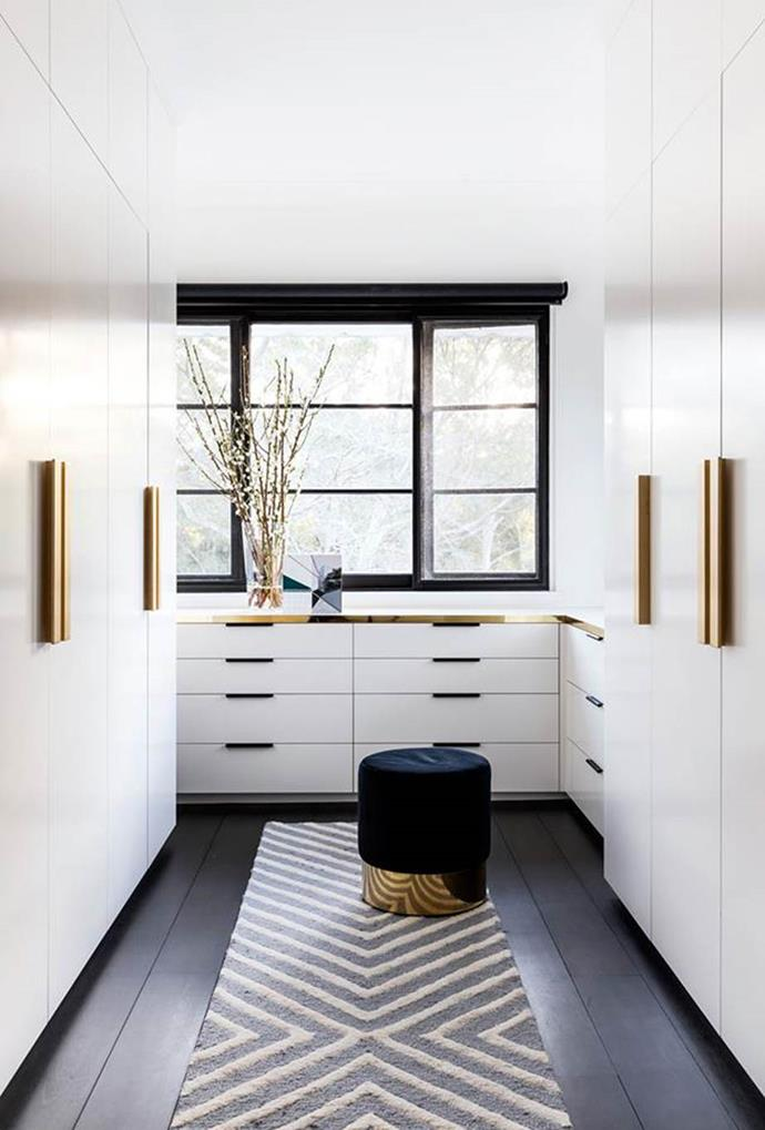 "Customise as much as you can to use all the space you have. Gold cabinetry accents, together with a statement rug and stylish ottoman create a dreamy walk-in wardrobe space in this [Spanish Mission home in Sydney](https://www.homestolove.com.au/spanish-mission-home-in-sydney-6324|target=""_blank""). Photo: Pablo Veiga 
