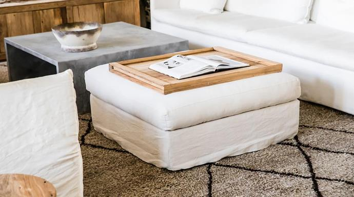 "Milan Ottoman in White, $1,150, [MCM House](https://www.mcmhouse.com/collections/ottoman/products/milan-ottoman|target=""_blank""