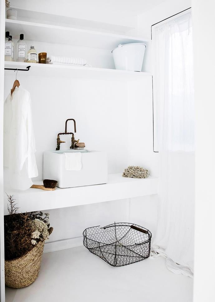 "With its concrete flooring, custom shelving, enamel basin and cotton gauze curtains from Numero 74, this room in a [French provincial coastal home](https://www.homestolove.com.au/coastal-french-provincial-home-7155|target=""_blank"") is one that we would happily visit every day! Photo: Maree Homer 