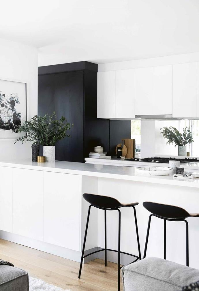 This kitchen uses a mirror as a splashback to bounce around light and make a room seem bigger. You might have a little vignette you want to capture in the reflection, whether it's a leafy aspect or a water feature in the courtyard. Photo: