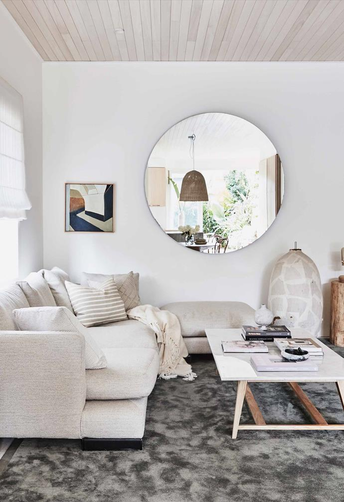 "Interior designer Kristy McGregor injected her own version of coastal cool in her [renovated Bondi abode](https://www.homestolove.com.au/kristy-mcgregor-house-21306|target=""_blank"") and the end result is stunning. Seeking to maximise the natural light that enters from the kitchen, a circular mirror acts as both a visual feature and light amplifier.<br><br>"