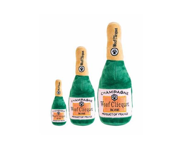 """Woof Clicquot Rose Champagne Dog Toy, $17.95, [Coco & Pud](https://cocoandpud.com.au/collections/designer-dog-toys/products/woof-clicquot-rose-champagne-dog-toy target=""""_blank"""" rel=""""nofollow"""")"""