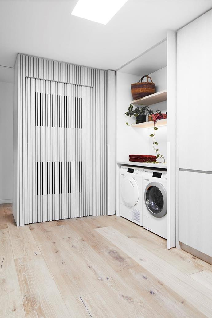 "The compact European laundry in this [garage turned guesthouse](https://www.homestolove.com.au/converted-garage-guesthouse-21350|target=""_blank"") is cleverly integrated into cupboard space. Photo: Armelle Habib 