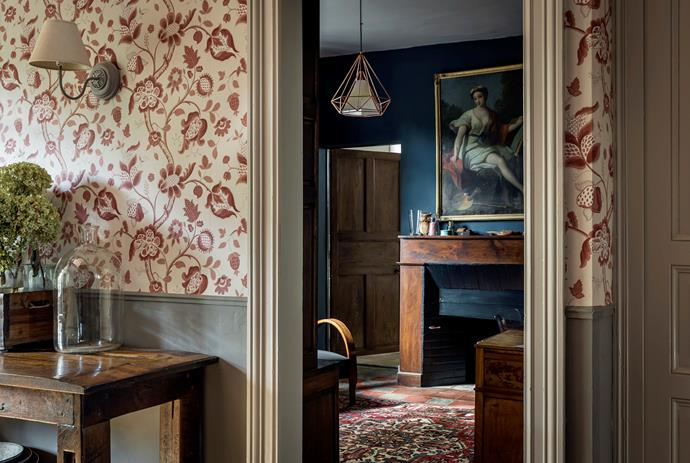 The wallpaper in the hall is High Street in Rouge from London Wallpapers III, a Little Greene design that is discontinued. The old workbench is from Australia. The study is painted in Farrow & Ball Hague Blue.