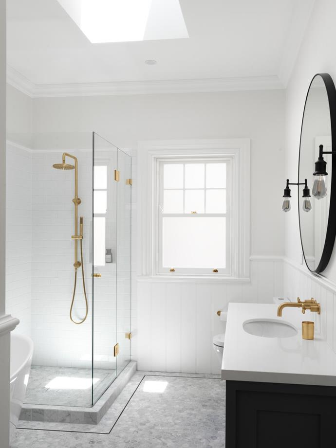 Wall and floor tiles, Lulo Tile. Easy Regency cladding, Gunnersens. Vanity benchtop in Caesarstone Snow. Shower and tapware, all Meir. Mirror from Mirror Mirror. Wall lights, Restoration Hardware.