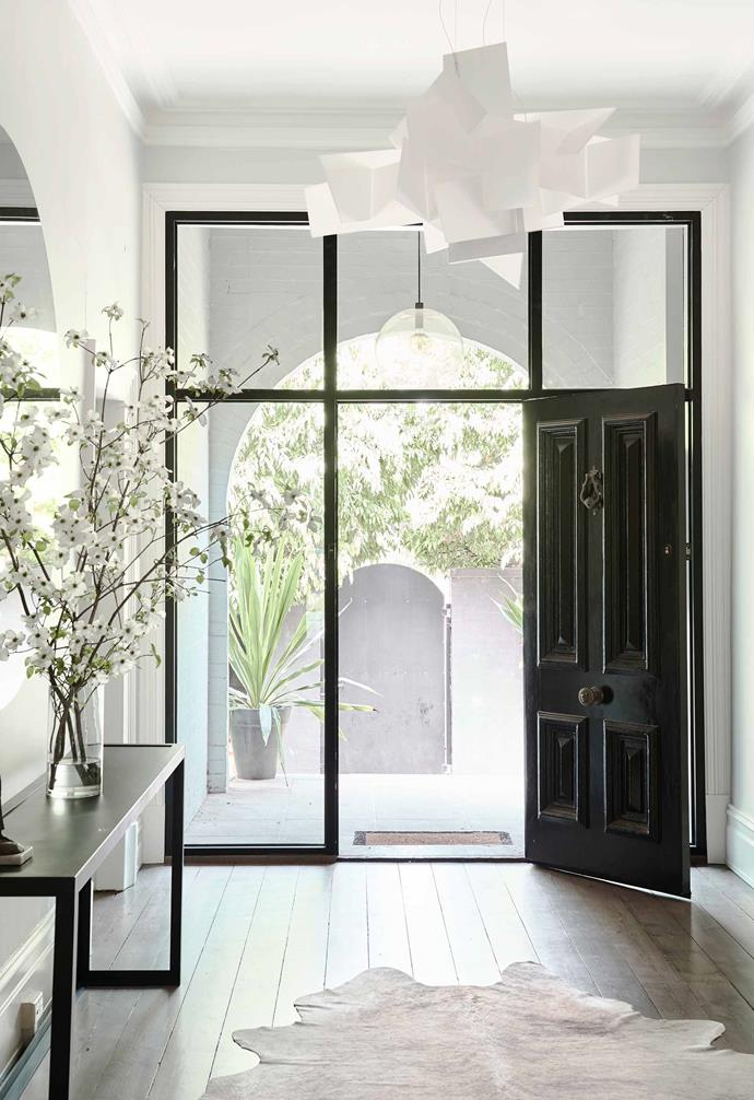 "**Entry** The approach to the home is defined by white arches and black metal-framed glass, with the front door opening under a whimsical Big Bang pendant lamp by Foscarini, available through [Space](https://www.spacefurniture.com.au/|target=""_blank""