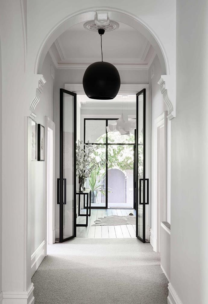 **Hallway** An Edwardian home in Melbourne has been given a contemporary facelift that celebrates both old and new aspects of the house, and the updated hallway is the best example of that. The archways are a nod to the home's heritage and complement the ornate walkway, while the sleek aluminium door frames look modern and elegant.