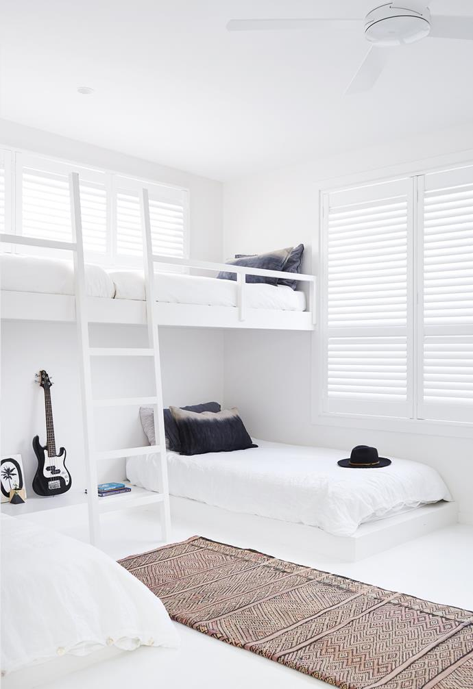 """In this relaxed [all-white home in Byron Bay](https://www.homestolove.com.au/relaxed-all-white-byron-bay-home-with-upcycled-details-19266 target=""""_blank"""") the shared kids room can host up to four children at any given time, with a clever layout making the most of limited space. While the stark white palette may seem risky, it helps to amplify a sense of space within the room."""