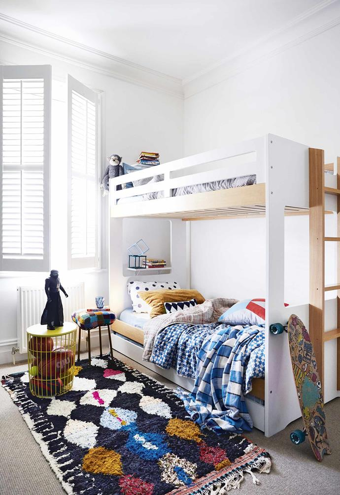 "A slimline bunk bed instantly transformed the childrens bedroom in this [renovated miner's cottage](https://www.homestolove.com.au/miners-cottage-renovation-geelong-18479|target=""_blank"") into a shared kids space. Playful patterned bedding adds a sense of fun while creating clear zones."