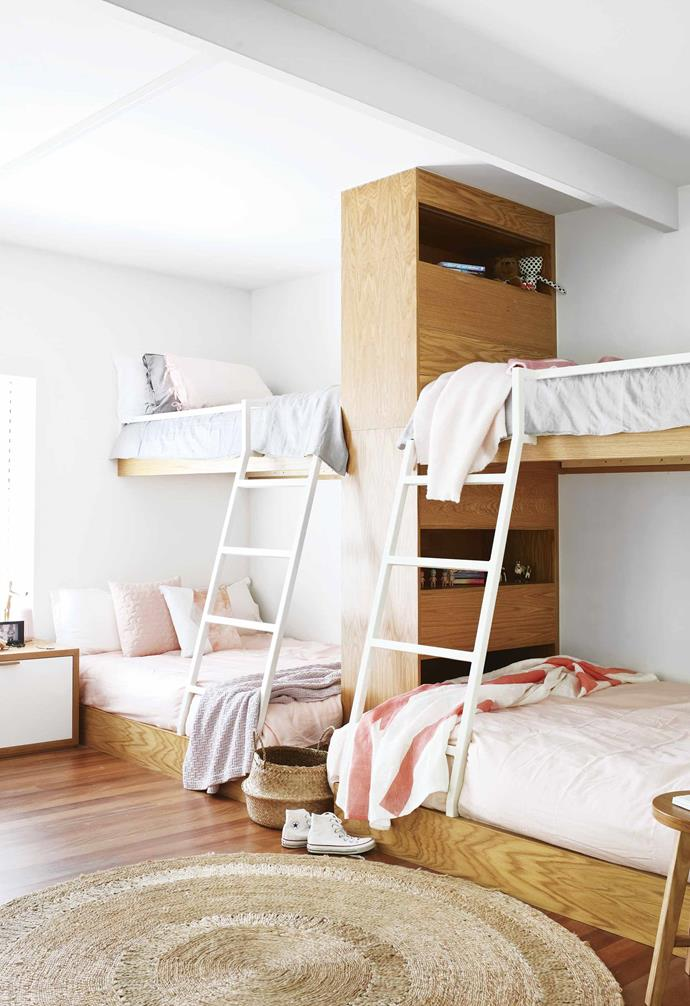 "In this [relaxed Noosa beach house](https://www.homestolove.com.au/beach-house-noosa-18843|target=""_blank"") the owners sought to create the perfect gathering space for their four daughters. Aiming to create a space for their children to bond, the double bunk bed set-up provides ample storage for each daughter."