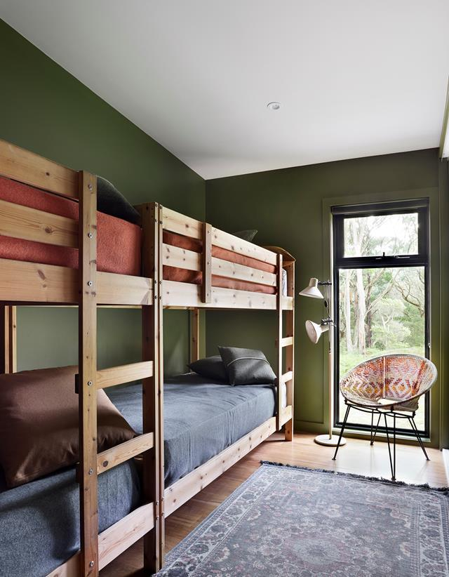 In the shared kids room of this eco-friendly weekender a long custom bunk bed was added to create ample space for up to four children to sleep comfortably in. The extra-long bed cleverly makes the most of the room's proportions.