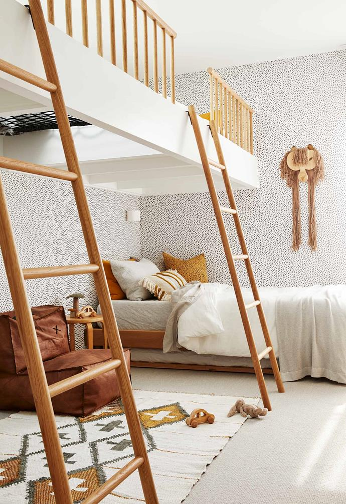 "In this [luxurious holiday home in Byron Bay](https://www.homestolove.com.au/barefoot-bay-villa-byron-bay-21018|target=""_blank"") the shared kids room features a striking wallpaper that adds a playful touch to the space. Timber ladders connect the ground floor play area to the elevated sleeping zone."
