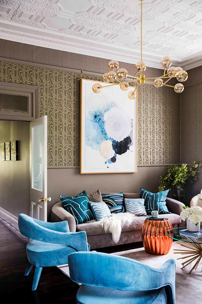 """In the formal lounge, Kelly Wearstler 'Agate' wallpaper sets the mood. """"This is an adult space most of the time, used in the evenings, so I wanted a dimly lit feel,"""" says the mother of two teens."""