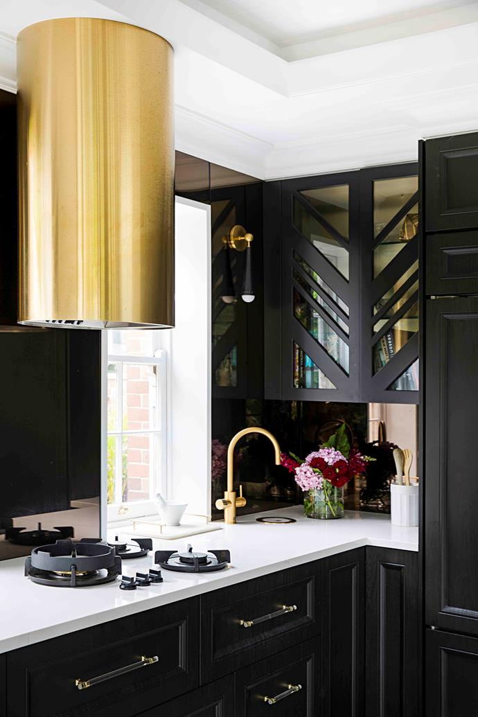A brass ABI Interiors sink, Brodware tapware in brass, along with the custom Qasair brass rangehood give the kitchen a glam feel.