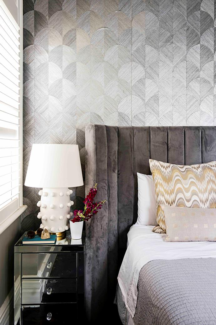 An opulent 'Lulu' bedhead from Darcy & Duke and a Kelly Wearstler lamp from Circa Lighting in the USA enhance the air of glamour in this covetable retreat, where a soft wash of grey (Dulux Grey Baron) calms the mood.