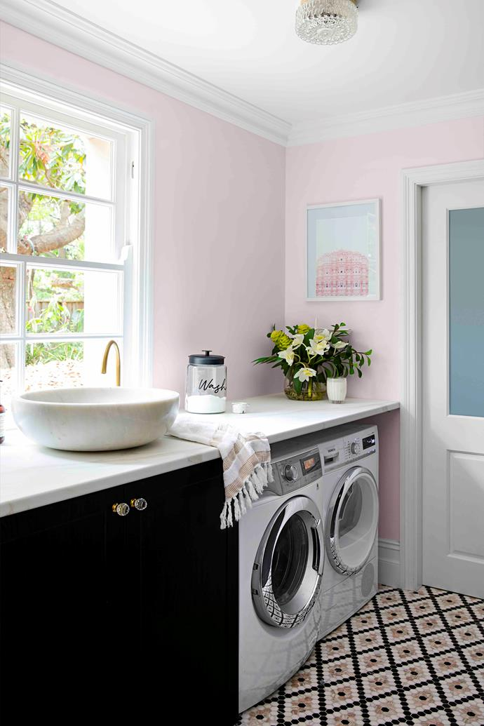 """""""When you have kids, the washing is the one job you never finish so the laundry should be a beautiful space,"""" says Sarah. The mosaic floor tiles are from Di Lorenzo and the walls are painted in Dulux Precious Pink Quarter."""