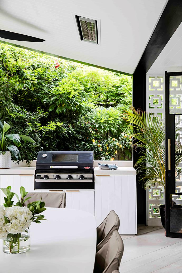 The Beefeater barbecue was one of the only pieces the owner couldn't source in brass, but was worth the compromise. An 80-year-old wisteria grows along the wall, which was a feature that drew the couple to this house.